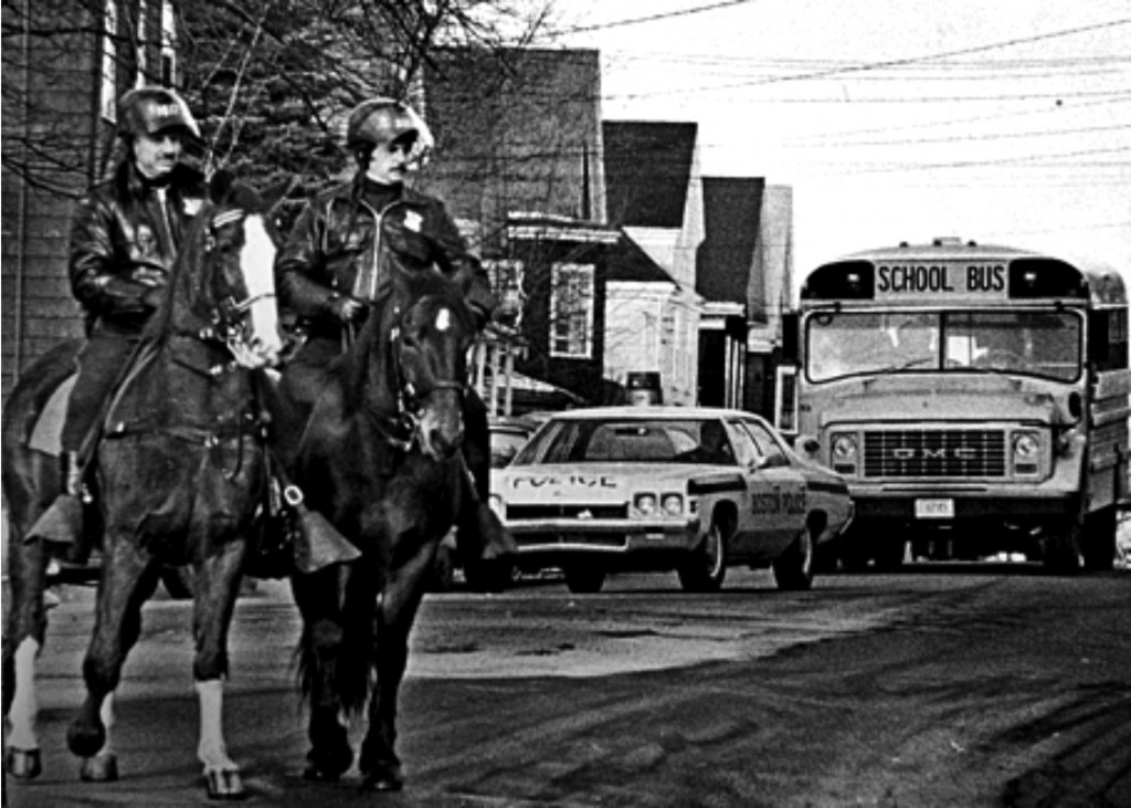 Boston Police on horseback stand guard for trouble in South Boston, MA, in fall of 1974 during forced busing to racially integrate the schools. Peter Bregg/AP