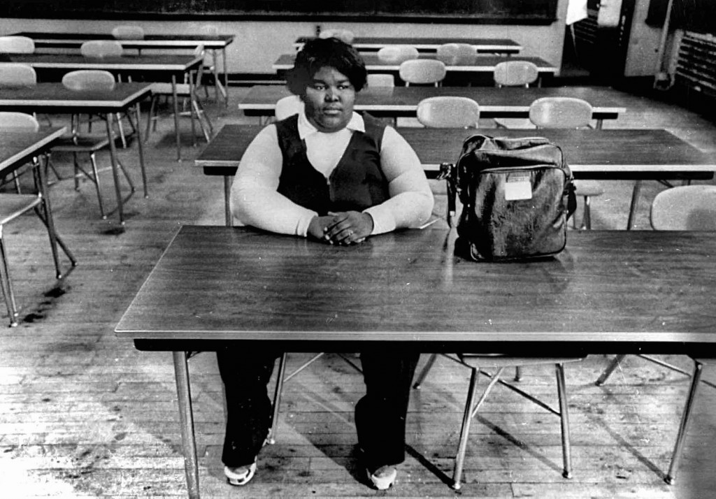 A lone black student sits in classroom of South Boston High School in fall  in Boston, MA, in 1974 during forced busing to racially integrate schools. White students boycotted the school for several months. Peter Bregg/AP