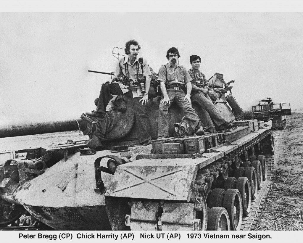 Peter Bregg with AP Photographers Nick Ut  and Chick Harrity south of Saigon, South Vietnam in 1973 while on patrol with South Vietnamese soldiers. Ut won the Pulitzer for his photo of Kim Phuc running down a highway after napalm strike burned off her clothes in 1972.