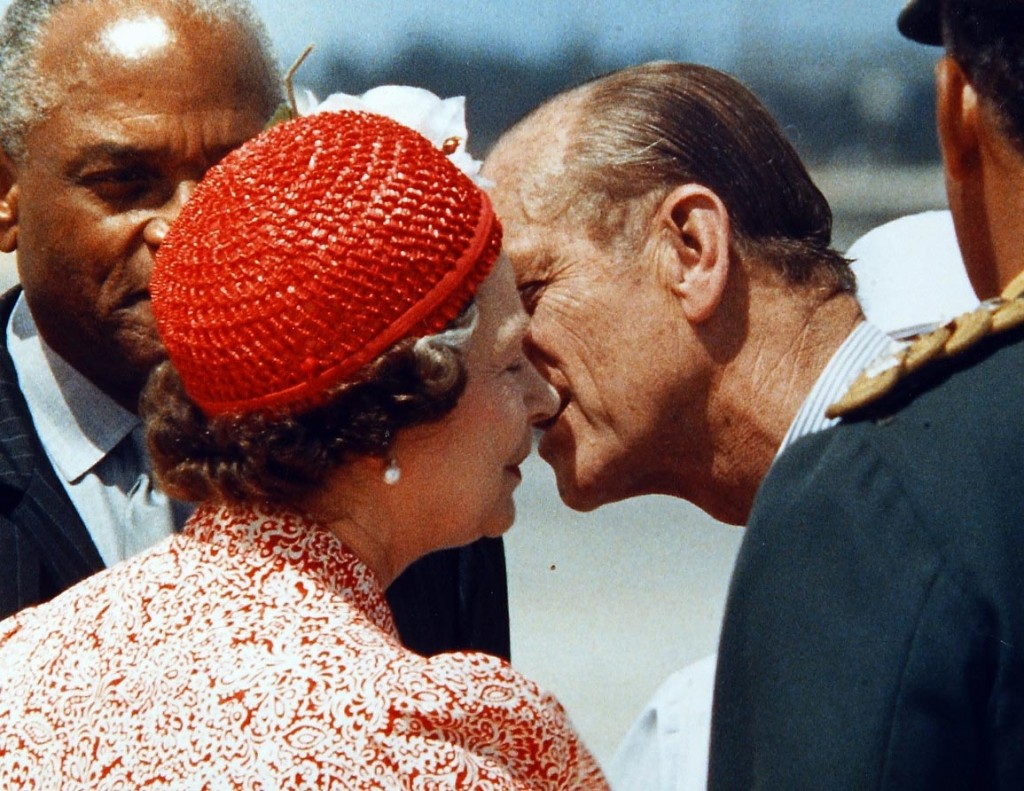 The Queen gets a farewell kiss from husband Prince Phillip as they prepare to depart Barbados in 1989. They were leaving on separate planes which is why they kissed in public. Peter Bregg