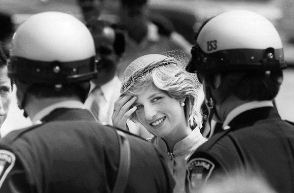 CPT107 August 31)--SAYING THANKS--Diana, Princess of Wales pushes hair from her face as she thanks her motorcycle police escort in Ottawa, prior to departing from Canada's captial in this June 22, 1983 photo. (CP PHOTO) 1983 (Stf-Peter Bregg)